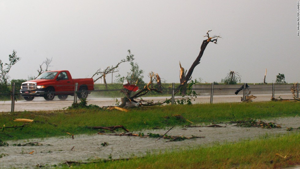 Shredded trees and debris are scattered along Interstate 40 near El Reno, Oklahoma, on May 31.
