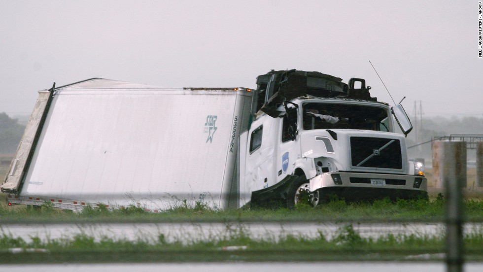 A semi tractor-trailer damaged by a tornado lies along I-40 just east of El Reno on May 31.