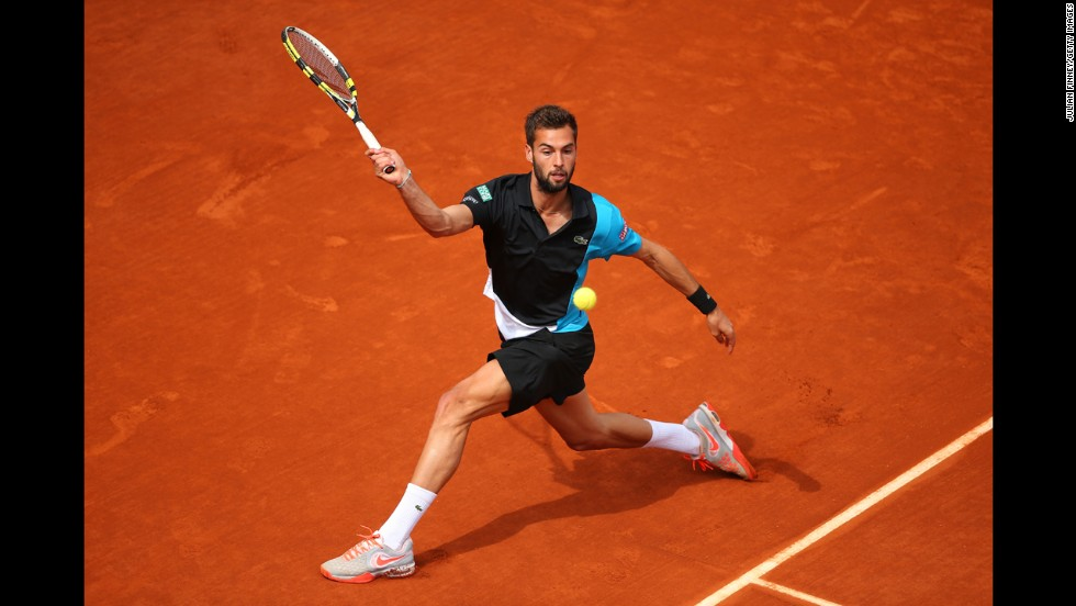 Paire plays a forehand to Nishikori.