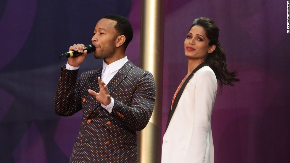 John Legend with Freida Pinto during the event. Pinto said she was grateful for the life she's been able to lead and wants to help other women and girls lead a better life.