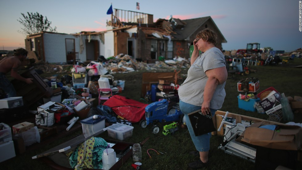 Yvonne Merritt stands among the things she was able to save from her home in El Reno on June 1.