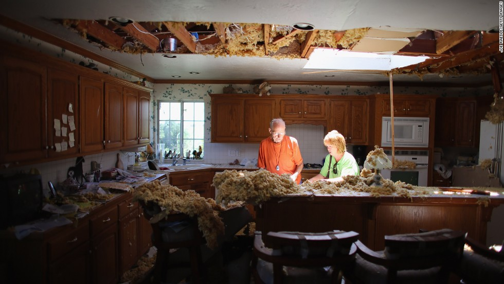Bill Thesing, who was injured in his home when a tornado hit, returns from the hospital to to salvage items from his home with the help of his friend Tammy Hicks on Saturday, June 1, in El Reno, Oklahoma.