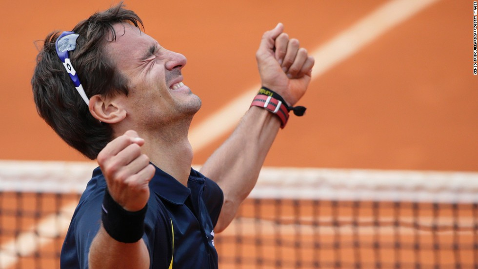 Spain's Tommy Robredo celebrates his victory over Spain's Nicolas Almagro on June 2. Robredo won 6-7 (5), 3-6, 6-4, 6-4, 6-4.