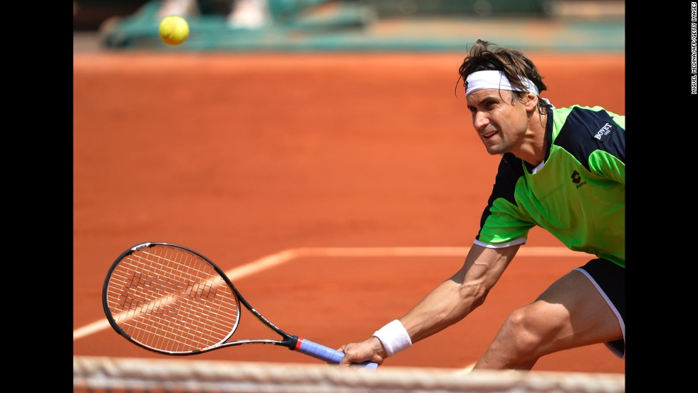 Spain's David Ferrer returns to South Africa's Kevin Anderson on June 2. Ferrer won 6-3, 6-1, 6-1.