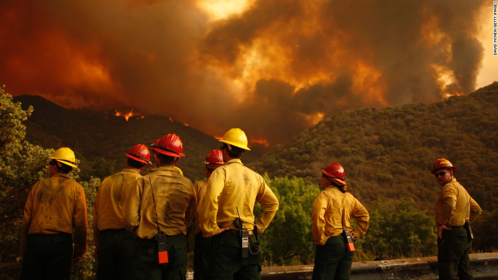 Firefighters watch as the Powerhouse Fire bears down on them as it approaches Lake Hughes on June 1.