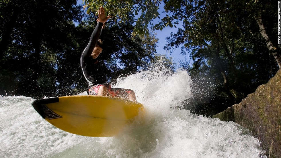 The Qiantang River is just one of a growing number of inner-city surfing spots around the world. Munich's Eisbach River (pictured) has been a popular surfing destination for more than four decades.
