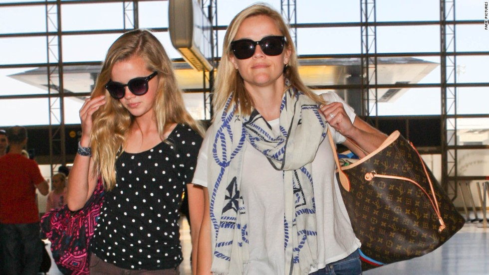 Reese Witherspoon and her daughter Ava walk through the airport in Los Angeles on May 31.