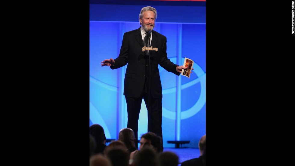 A bearded Douglas presents the award for Outstanding Film - Wide Release at the 2006 GLAAD Media Awards in New York City. In August 2010, he was diagnosed with throat cancer and began eight weeks of chemotherapy and radiation to treat a Stage 4 cancerous tumor.