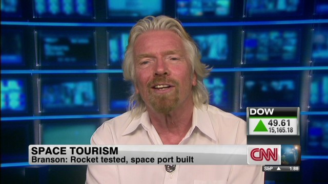 Branson: Space journeys to start in Dec.