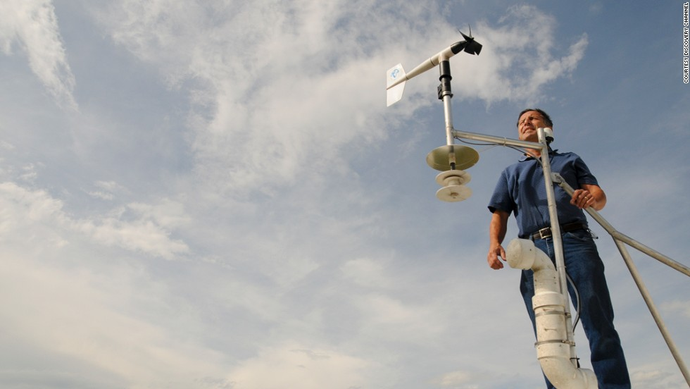 Tim Samaras, 54, stands with an anemometer, a device used to measure wind speed. The May 31 tornado had winds of at least 136 mph, according to a preliminary National Weather Service rating.