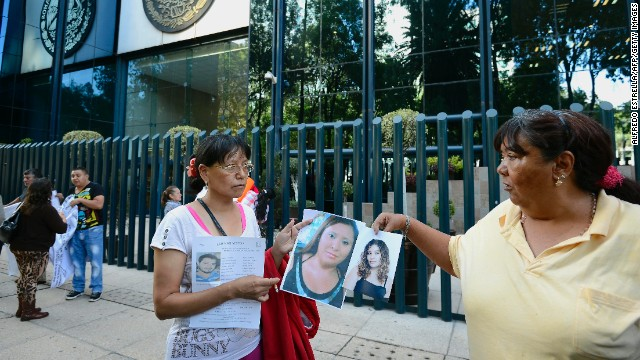 "Relatives of twelve people who disappeared in a bar named ""Heaven"" protest in front of the General Attorney's office, after a meeting with the Mexican authorities in Mexico City on May 31, 2013. On May 25 a group of twelve youngster was allegedly abducted in the bar. AFP PHOTO/Alfredo Estrella        (Photo credit should read ALFREDO ESTRELLA/AFP/Getty Images)"
