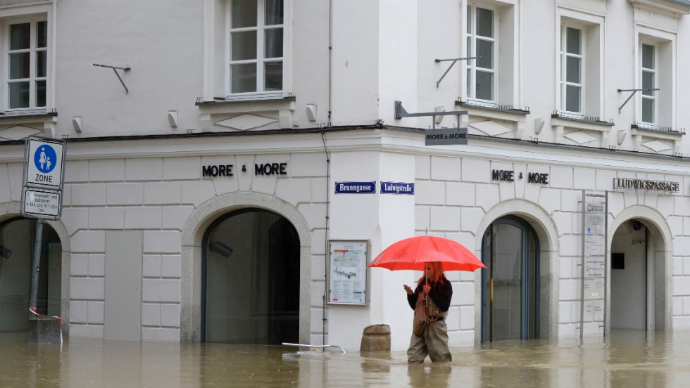 A woman wades through a flooded street in Passau, Germany, on June 3.