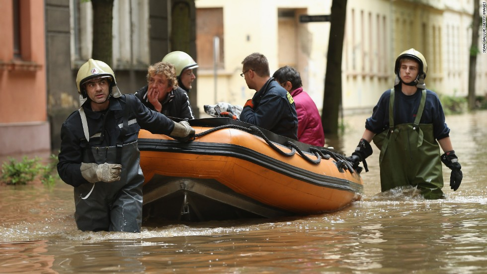 Firefighters evacuate local residents in Zeitz, Germany, on June 3 from a street flooded the night before by the nearby Weisse Elster River.
