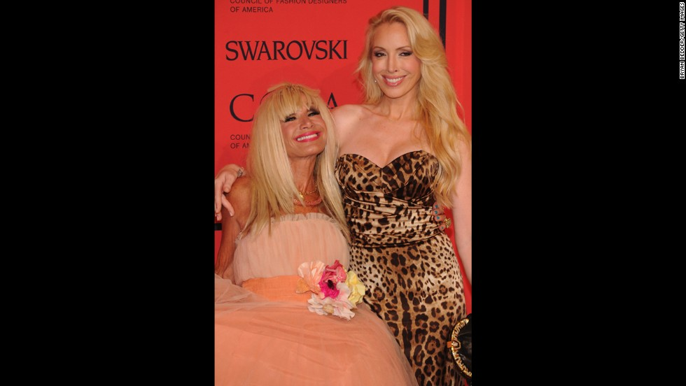 "Designer <a href=""http://www.cnn.com/2012/06/08/living/betsey-johnson-stores-closing"">Betsey Johnson</a>, left, and her collaborator daughter Lulu celebrate their colorful, vampy style on the red carpet. Betsey's confectionary tulle dress was paired with flip-flops and a blue pedicure."