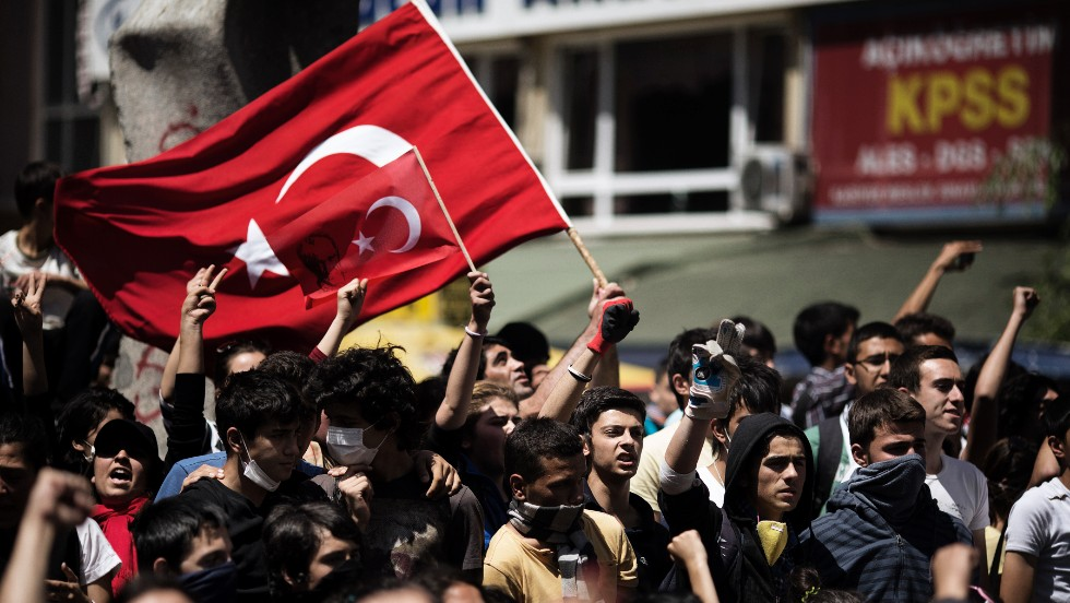Demonstrators wave their national flag on June 4, during a protest in Ankara.