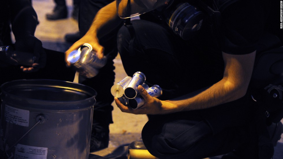 Riot policemen unload tear gas during clashes in Istanbul on June 3.