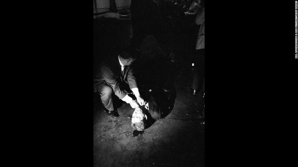 A wounded Paul Schrade, a regional director of the United Auto Workers Union, labor chair of Robert Kennedy's campaign and one of five other people shot by Sirhan Sirhan, on the floor of the kitchen at the Ambassador Hotel, June 5, 1968.