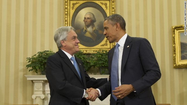 US President Barack Obama(R) shakes hands during a bilateral meeting with Chilean President Sebastian Pinera at the White House in Washington, DC, June 4, 2013
