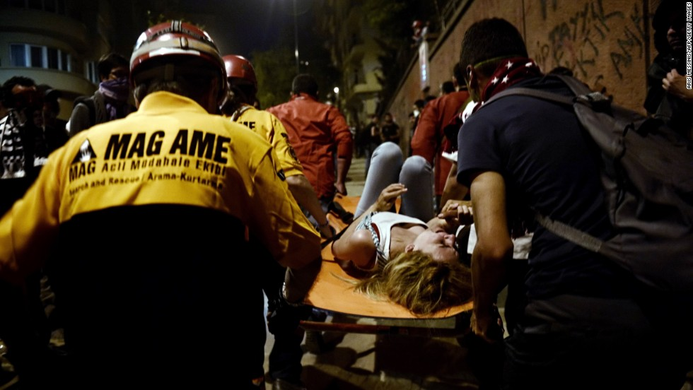 Paramedics carry a woman injured during clashes between demonstrators and riot police in Istanbul on June 4.