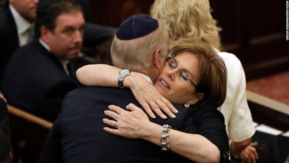Bonnie Englebardt Lautenberg, the senator's widow, embraces Vice President Joe Biden before the service.