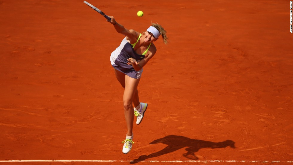 Maria Sharapova of Russia serves to Victoria Azarenka of Belarus during their semifinal match of the French Open at Roland Garros in Paris, on June 6.