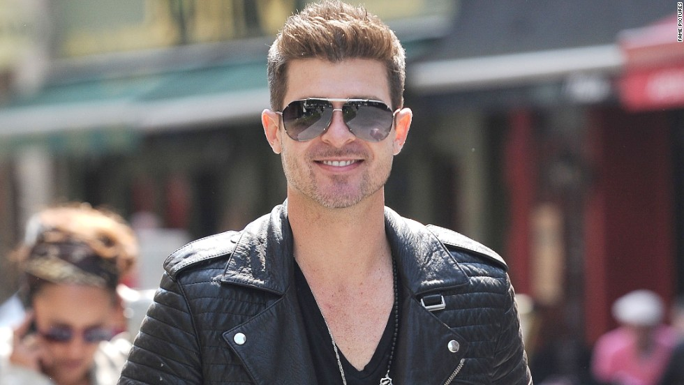 Singer Robin Thicke takes a sunny stroll in London on June 6.