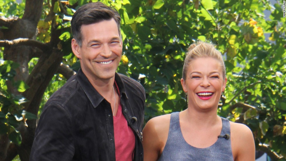 "Eddie Cibrian and LeAnn Rimes share a laugh on the set of ""Extra"" June 5."