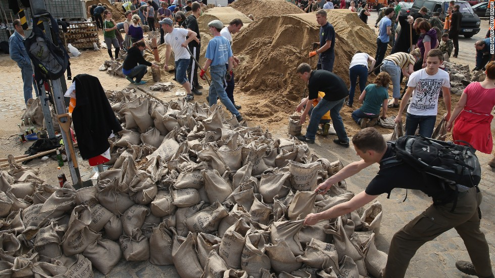 Volunteers fill sandbags to protect Dresden, Germany, from rising floodwaters of the Elbe River on June 6.