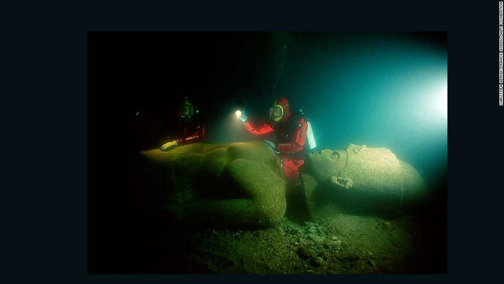 Franck Goddio and divers of his team are inspecting the statue of a pharaoh. The colossal statue is of red granite and measures over 5 metres. It was found close to the big temple of sunken Heracleion.