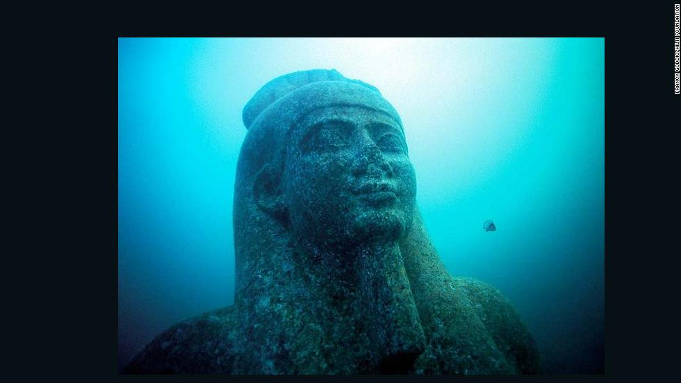 Head of a colossal statue of red granite (5.4 m) representing the god Hapi, which decorated the temple of Heracleion. The god of the flooding of the Nile, symbol of abundance and fertility, has never before been discovered at such a large scale, which points to his importance for the Canopic region.