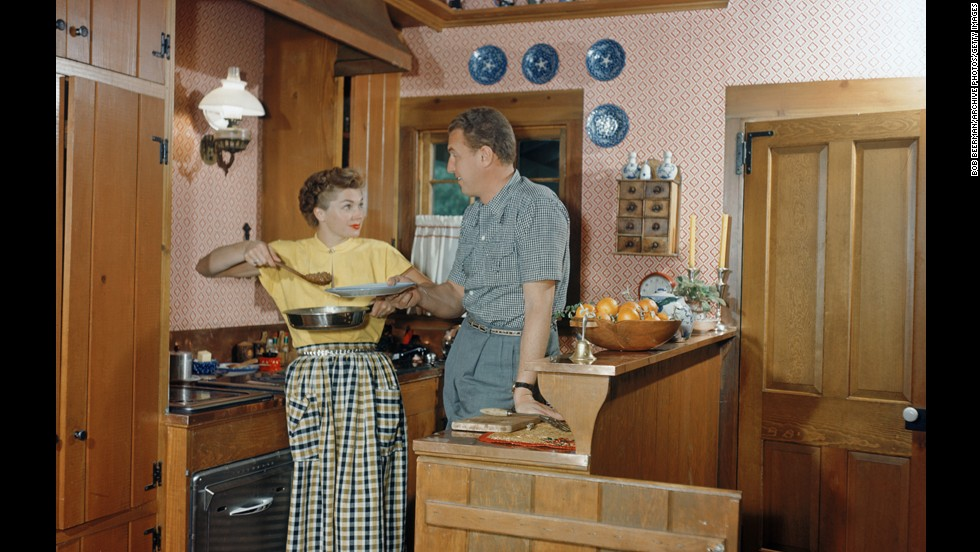 Williams and her husband, Ben Gage, prepare dinner circa 1950.