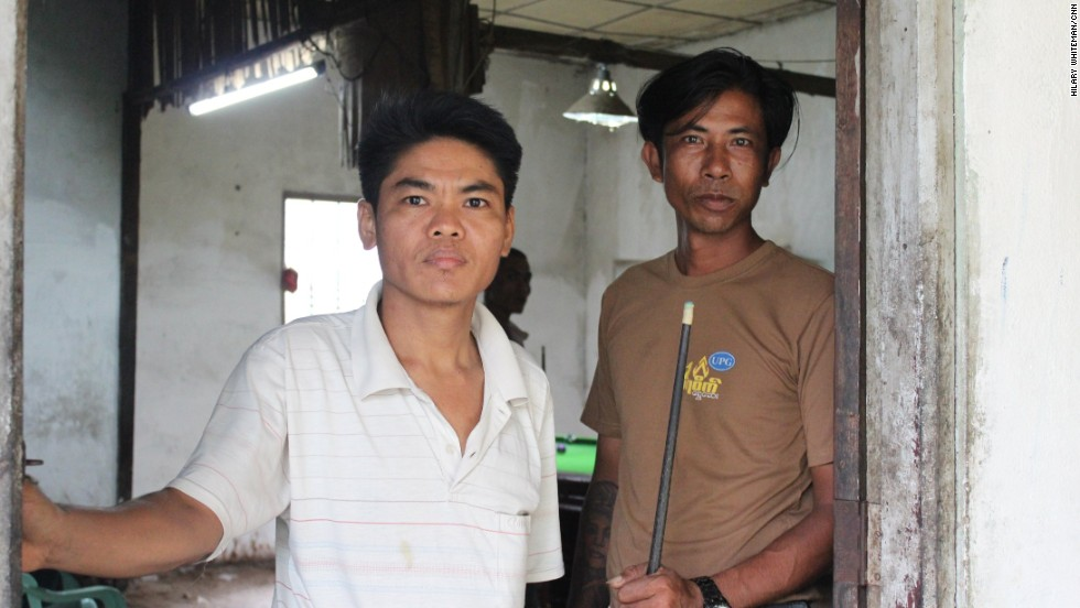 Blackouts are common in Myanmar due to an old and neglected energy network that only reaches a quarter of the country's population of 60 million people. Aye Kyaing (L), who rents out a pool table in the front room of his house in Yangon, says the situation has already improved.