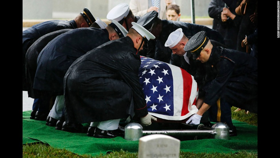 Lautenberg's casket is set down during his burial at Arlington on June 7.