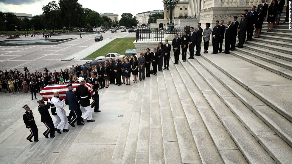 An armed forces team carries the senator's casket up the Senate steps of the Capitol to lie in repose on Thursday, June 6.