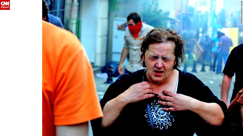 "Police have used tear gas, or pepper spray, at some demonstrations. iReporter <a href=""http://ireport.cnn.com/docs/DOC-981786"">Görkem Keser </a>captured this image of a woman suffering effects of the gas."