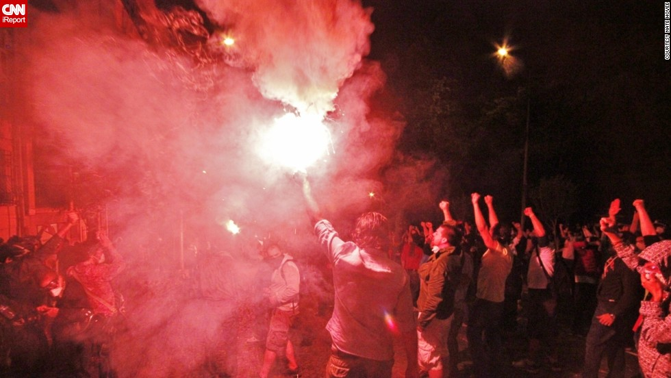 "Cities in Turkey have been rocked by days of anti-government protests. This image by iReporter <a href=""http://ireport.cnn.com/docs/DOC-982924"">Nate Hovee</a> from Sunday shows protesters chanting and surrounding a flare in Istanbul."
