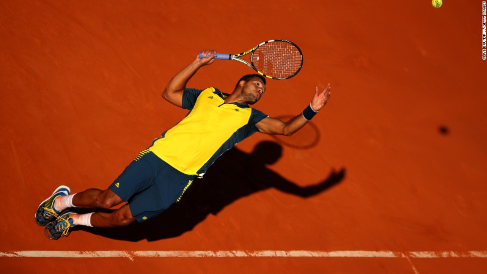 Tsonga reaches to hit a return to Ferrer on June 7.