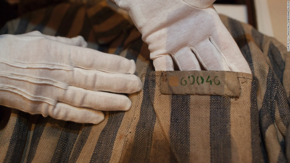 U.S. Holocaust Memorial Museum textile conservator Cynthia Hughes carefully handles a concentration camp uniform that had been worn by a Holocaust survivor. The museum embarked on a national tour this year to commemorate its 20th anniversary. Curators were on hand to review and collect artifacts.