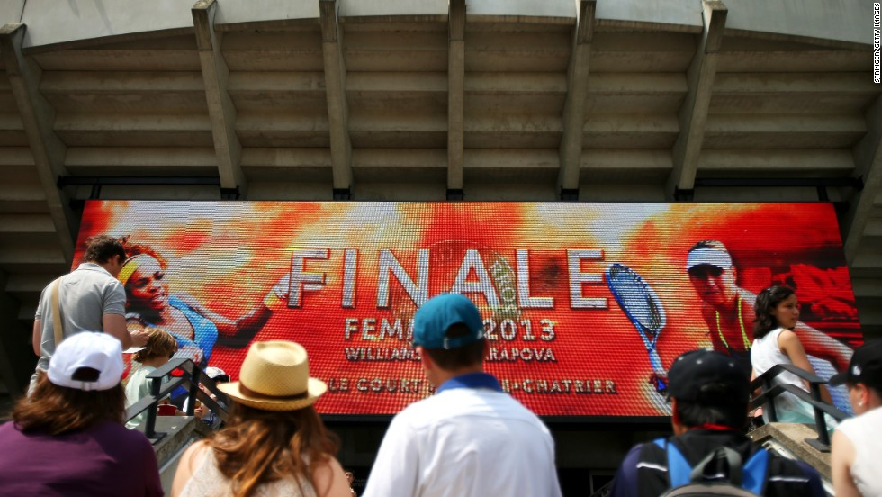 Tennis fans watch the big screen outside Court Suzanne Lenglen in Paris before the match between Williams and Sharapova.