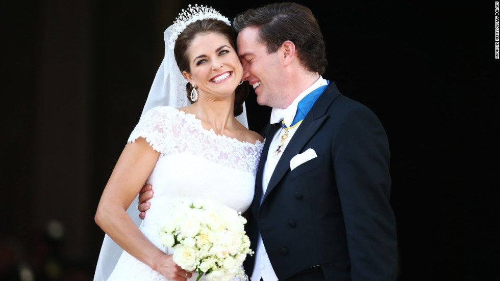Princess Madeleine of Sweden and Christopher O'Neill appear on the balcony after their wedding ceremony hosted by King Carl Gustaf XIV and Queen Silvia at the Royal Palace in Stockholm on Saturday, June 8.