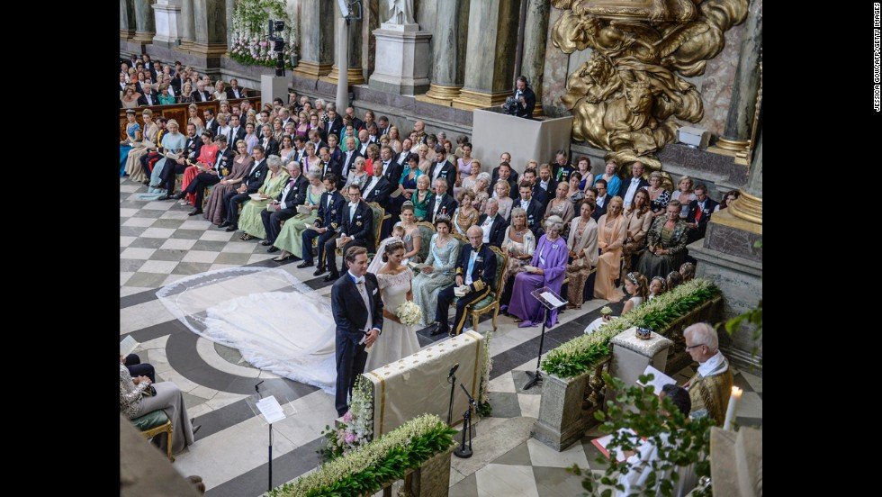 Princess Madeleine and Christopher O'Neill stand at the alter at the Royal Chapel in Stockholm.