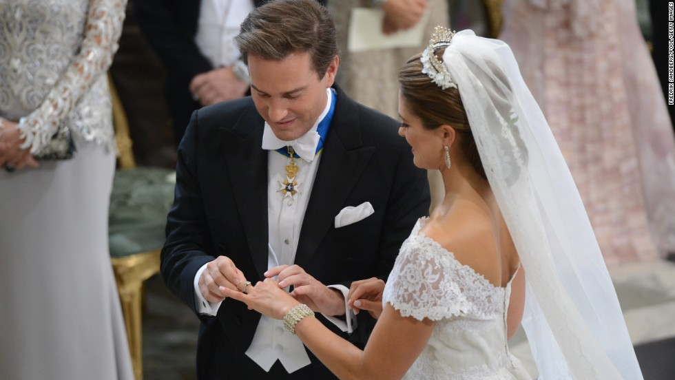 Princess Madeleine of Sweden and Christopher O'Neill exchange rings during the wedding ceremony.