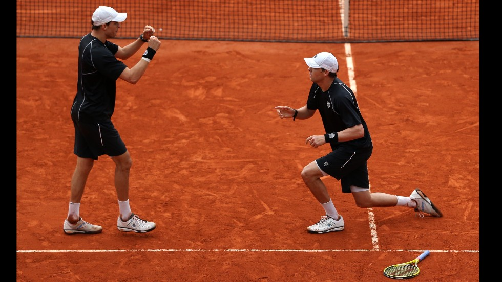 Bob, right, and Mike Bryan celebrate the match point.