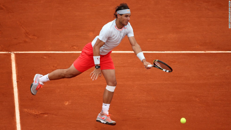Nadal plays a forehand against Ferrer.