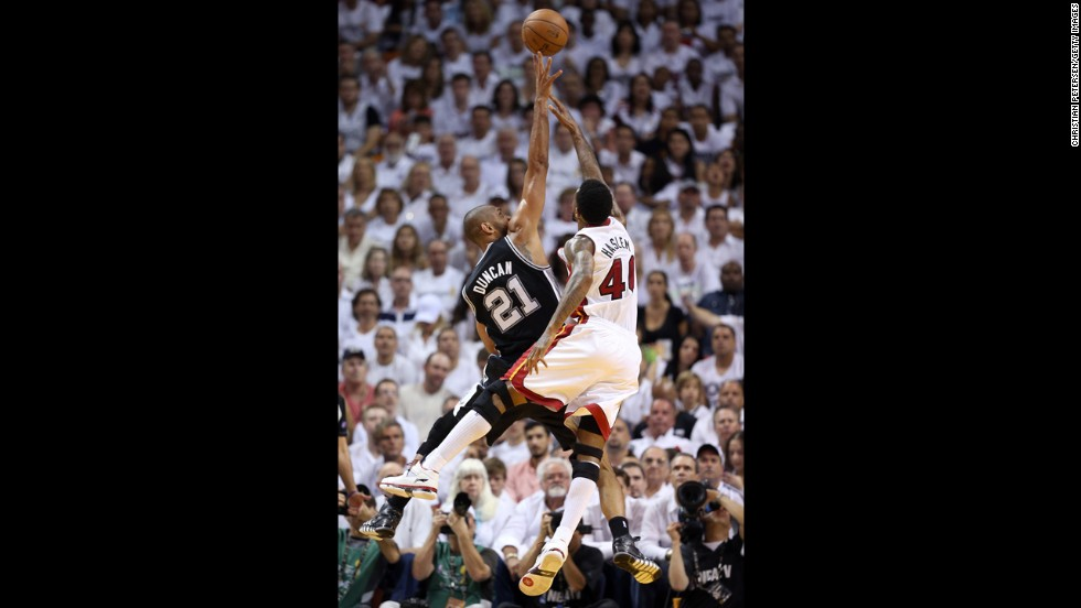 Tim Duncan of the San Antonio Spurs goes up for a shot over Udonis Haslem of the Miami Heat.