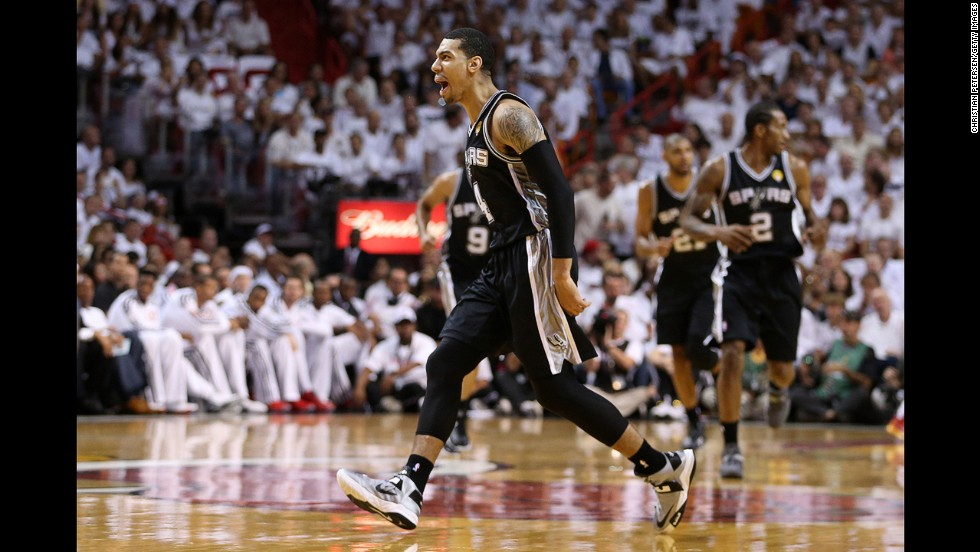 Danny Green of the San Antonio Spurs reacts after making a three-pointer in the first quarter against the Miami Heat.