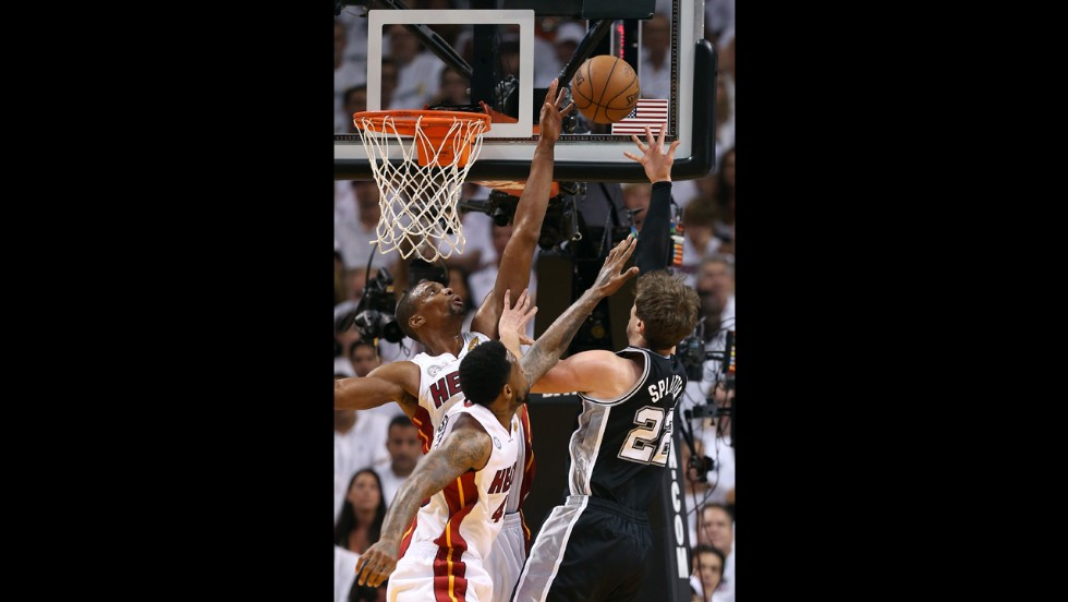 Chris Bosh of the Miami Heat blocks the shot of Tiago Splitter of the San Antonio Spurs in the first quarter.
