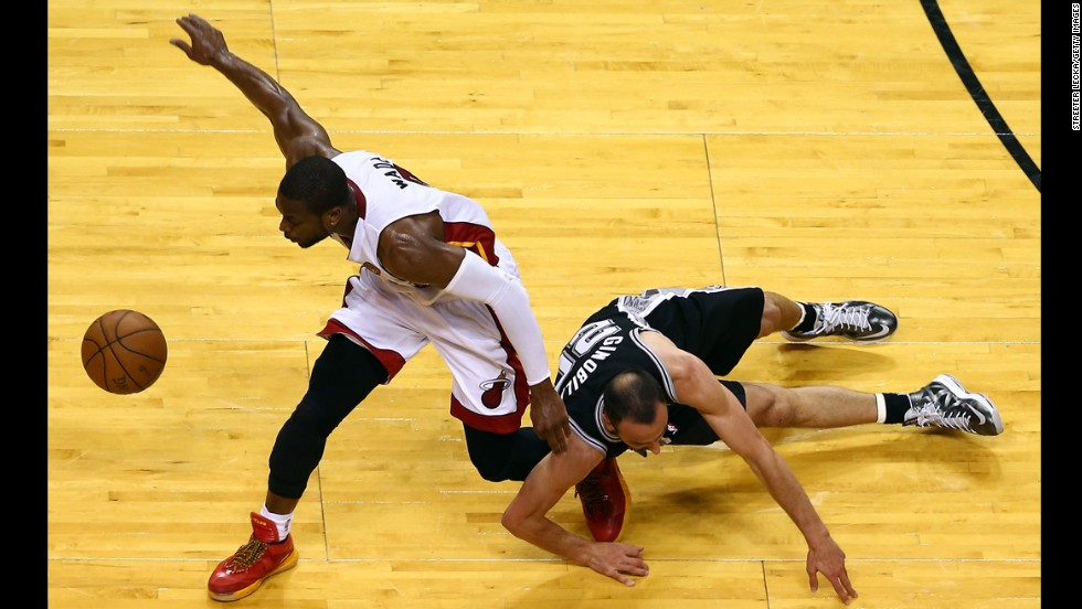 Dwyane Wade of the Miami Heat and Manu Ginobili of the San Antonio Spurs go after a loose ball.
