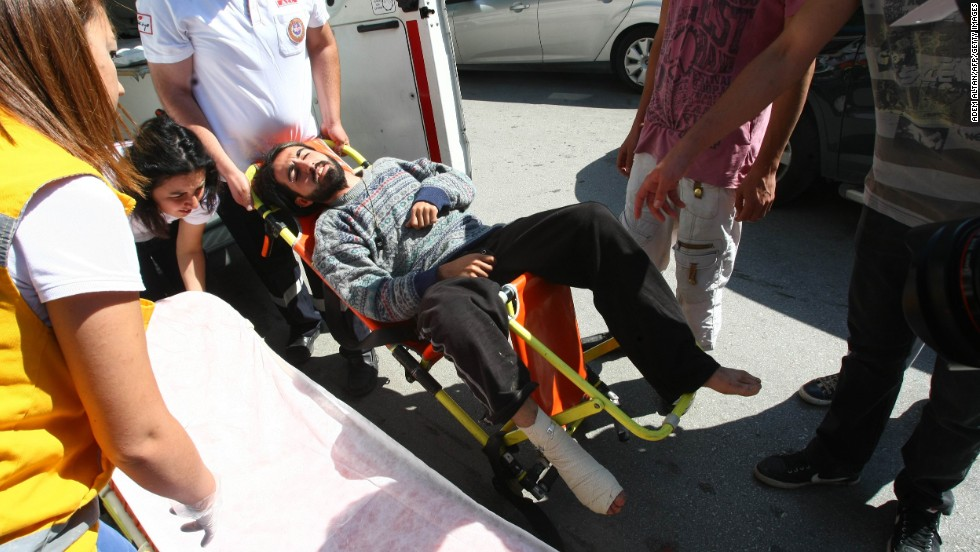 Medics carry Yasin Ayhan, 23, a protester who broke his leg in a raid early Monday, June 10, in Kugulu Park. Riot police doused thousands of protesters in Ankara with tear gas and jets of water for a second straight night.
