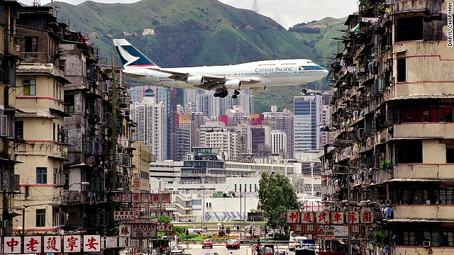 "Probably the most iconic shot of Kai Tak International Airport --a departing Cathay Pacific's flight captured in between the walk-up buildings in Kowloon City. Daryl Chapman, a 40-year-old photographer, recalled, ""That photo was taken in To Kwa Wan just at the entrance of the airport tunnel (now Kai Tak tunnel)."""